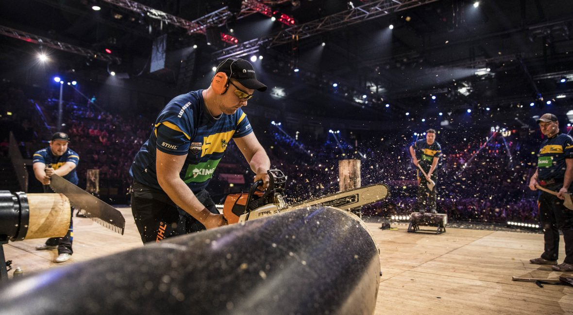 Team Sweden performs during the Team Competition of the Stihl Timbersports World Championships at the Porsche-Arena in Stuttgart, Germany on November 11, 2016.